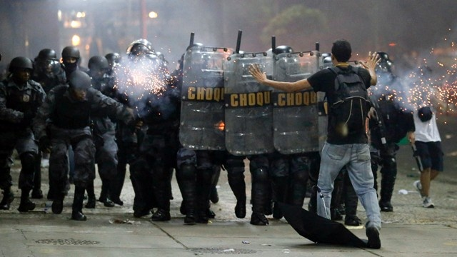 Brazil-protester-tries-to-stop-riot-police-jpg
