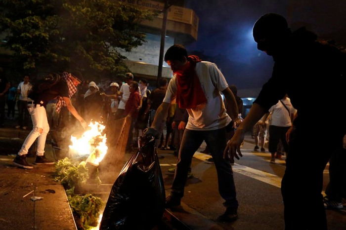 Demonstrators make a barricade of burning garbage during a protest against Venezuela's President Nicolas Maduro's government in Caracas