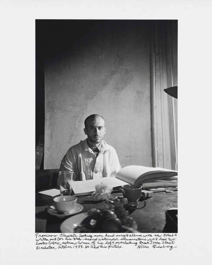 Francesco Clemente looking over hand-script album