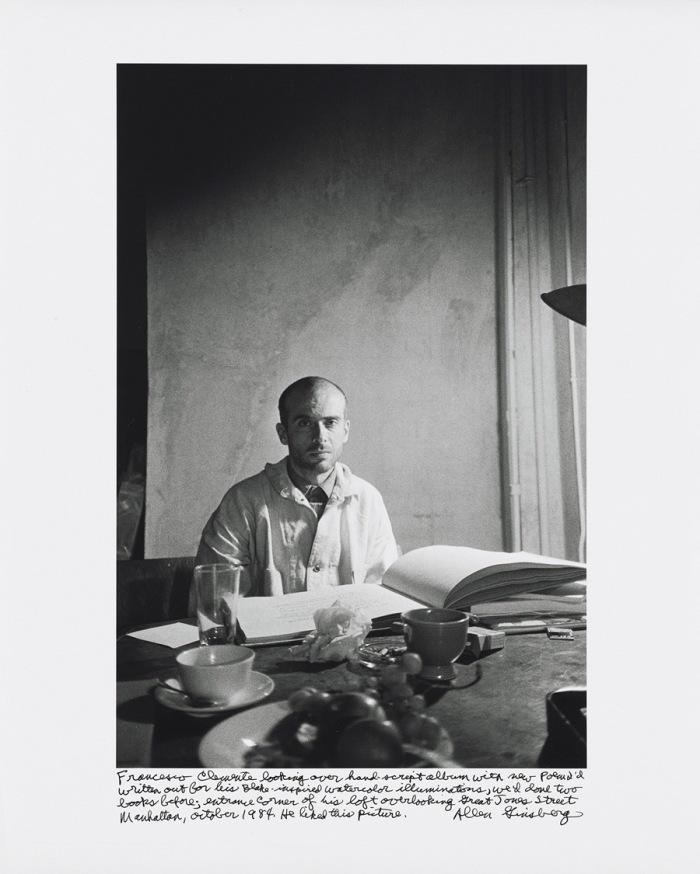 Francesco Clemente looking over hand-script album